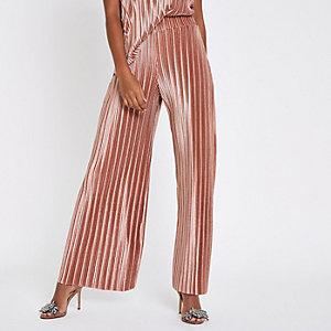 Roze fluwelen plissé broek met wijde pijpen