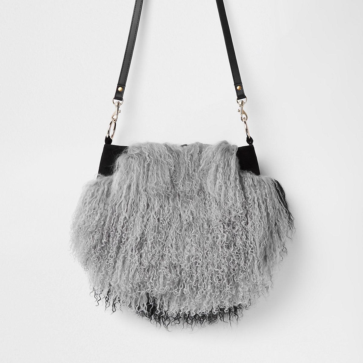 Grey leather Mongolian fur cross body bag