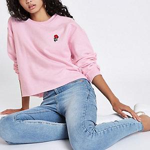 Roze sweatshirt met geborduurde roos