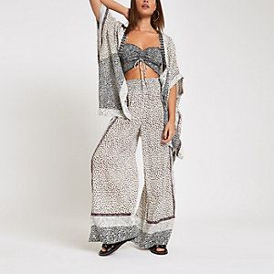 Cream animal print wide leg beach trousers