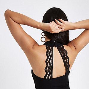 Zwarte cropped bustier met V-hals en detail op de rug
