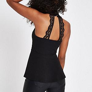 Zwarte top met V-hals, peplum zoom en kant op de rug