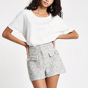 Weiße, kurzärmelige Bluse mit transparentem Saum