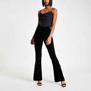 Black velvet flared trousers