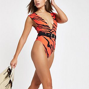 Orange zebra print belted plunge swimsuit