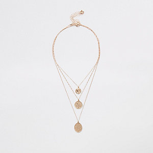 Gold tone layered coin necklace