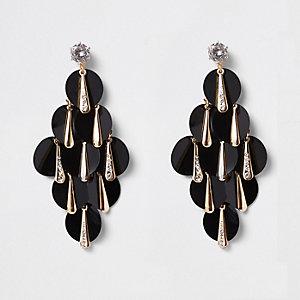 Boucles d'oreilles dorées à sequins noirs