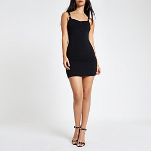 Petite black buckle strap bodycon mini dress