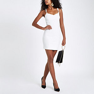 White buckle strap bodycon mini dress