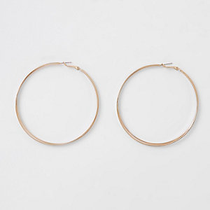 Gold tone interlinked hoop earrings