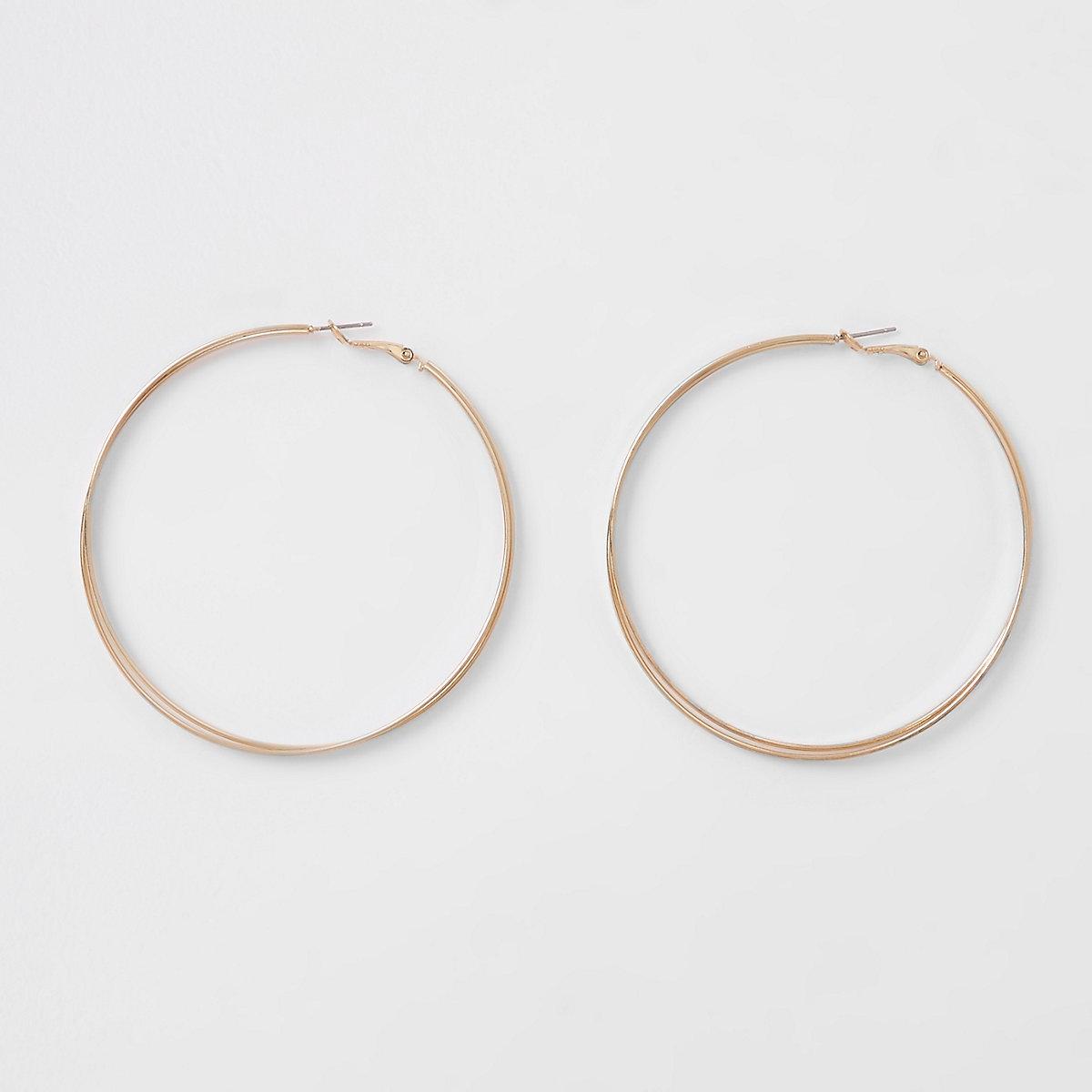 Gold tone interlinked hoop earrings