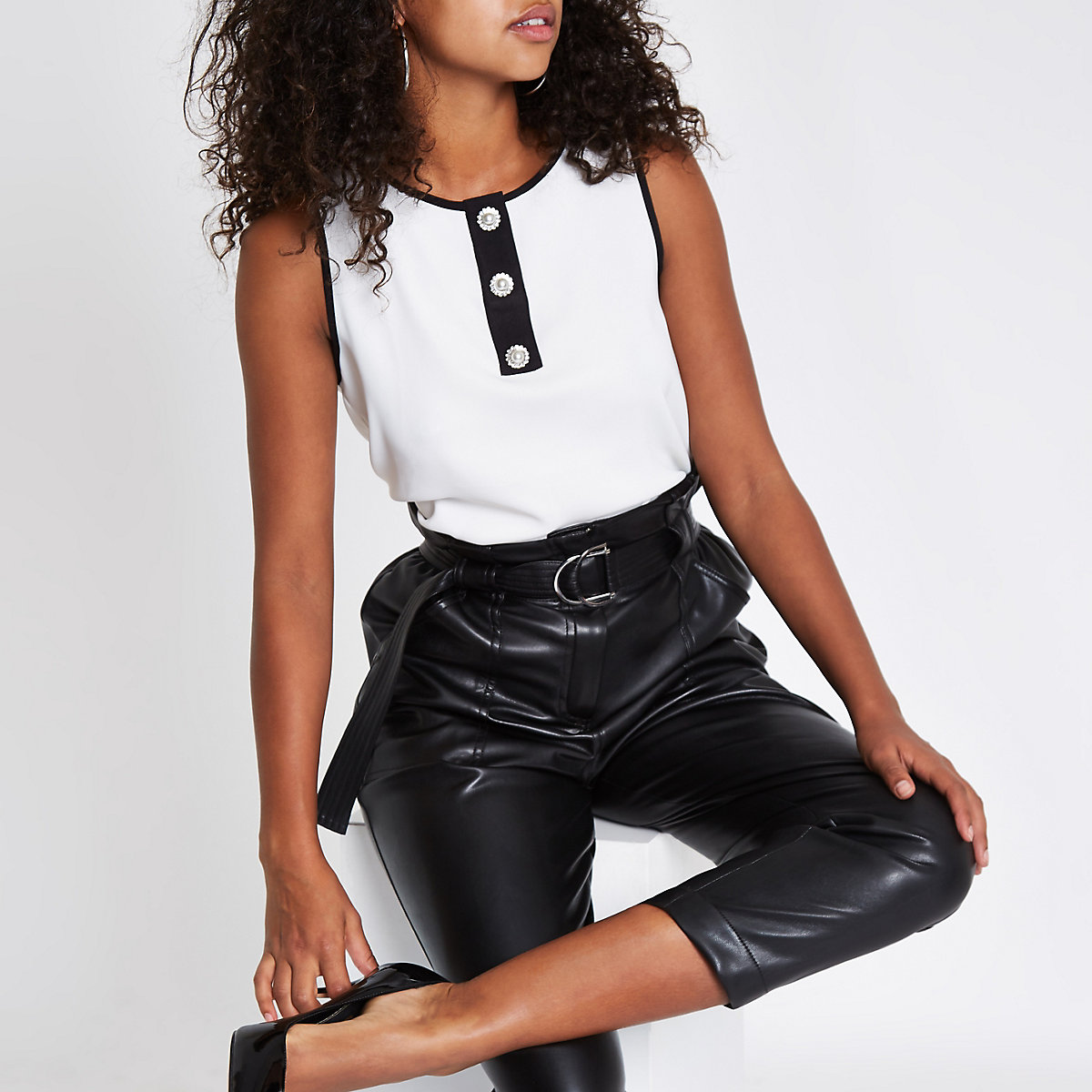 White pearl button sleeveless contrast top