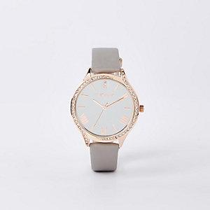 Grijs horloge met roségoudkleurige wijzerplaat en diamantjes