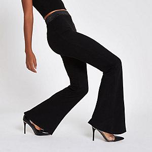 Zwarte jersey broek met wijde pijpen en lurex