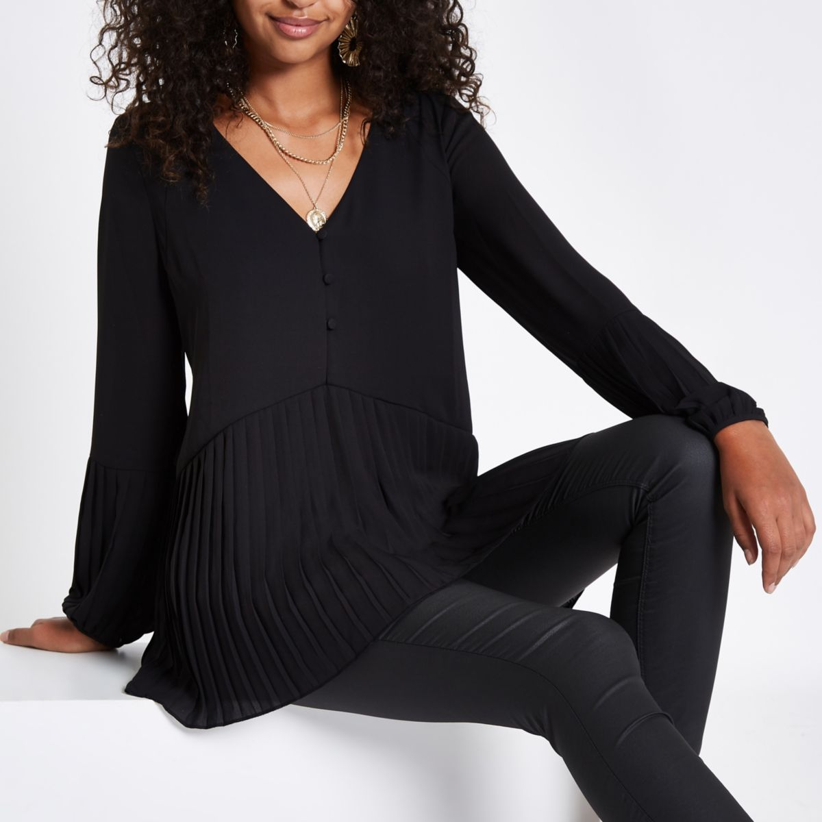 Black button plisse hem blouse