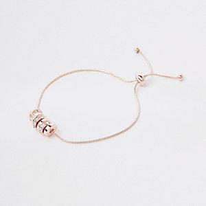 Rose gold tone paved circle lariat bracelet