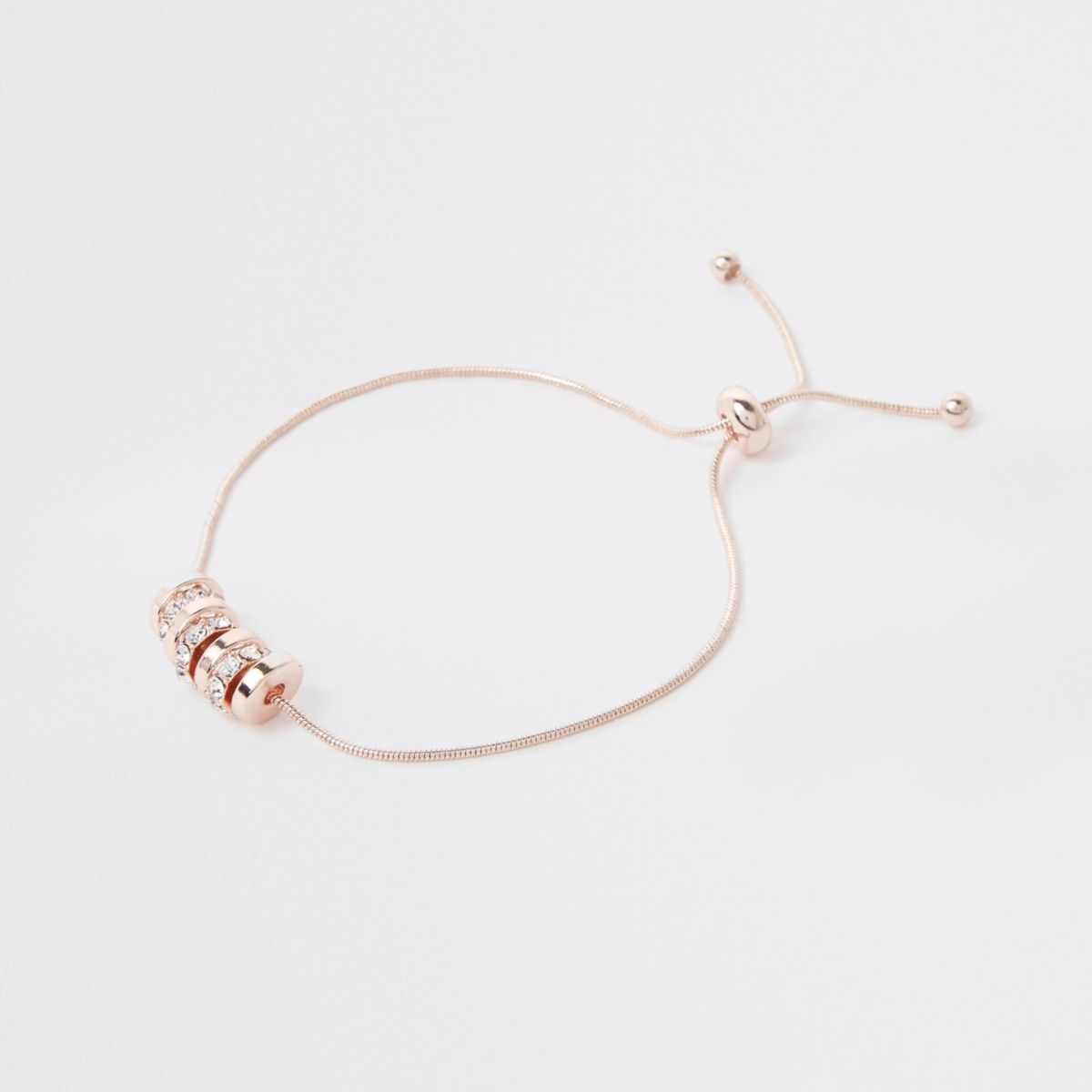 Rose gold tone paved circle lariat bracelet