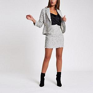 Mini-jupe en maille bouclée blanche à franges