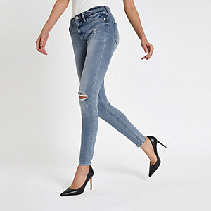 Molly - Lichtblauwe ripped jegging met halfhoge taille