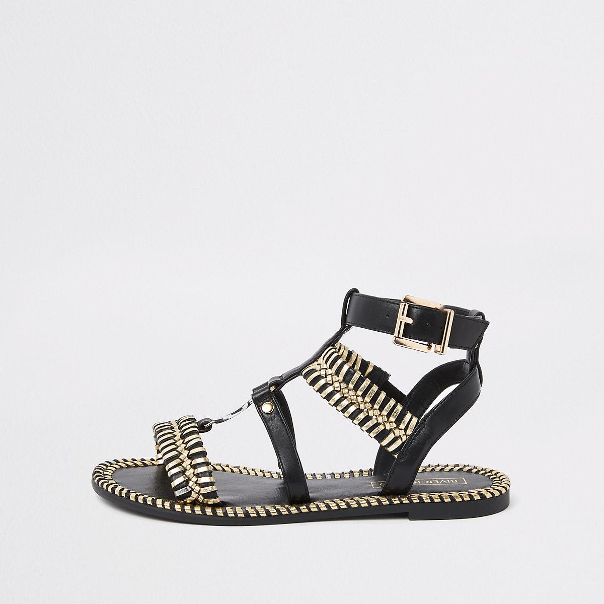 Black caged gold tone sandals