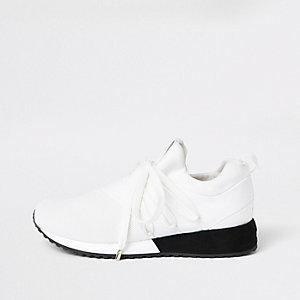 Baskets de course blanches à lacets