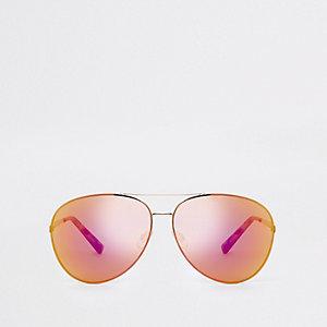 Lunettes de soleil aviateur dorées aux verres rouges