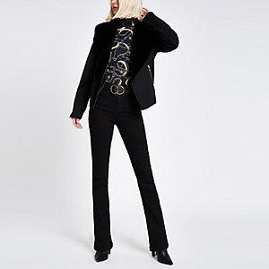 Zwart openvallend jasje van imitatiesuède