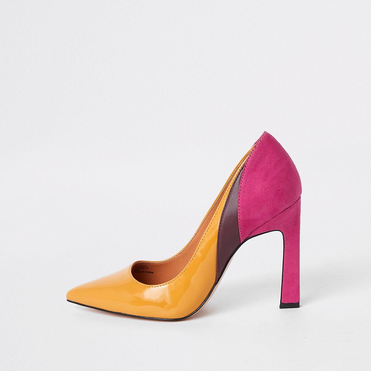Yellow spliced heel court shoes