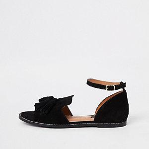 Schwarze Schuhe aus Wildleder