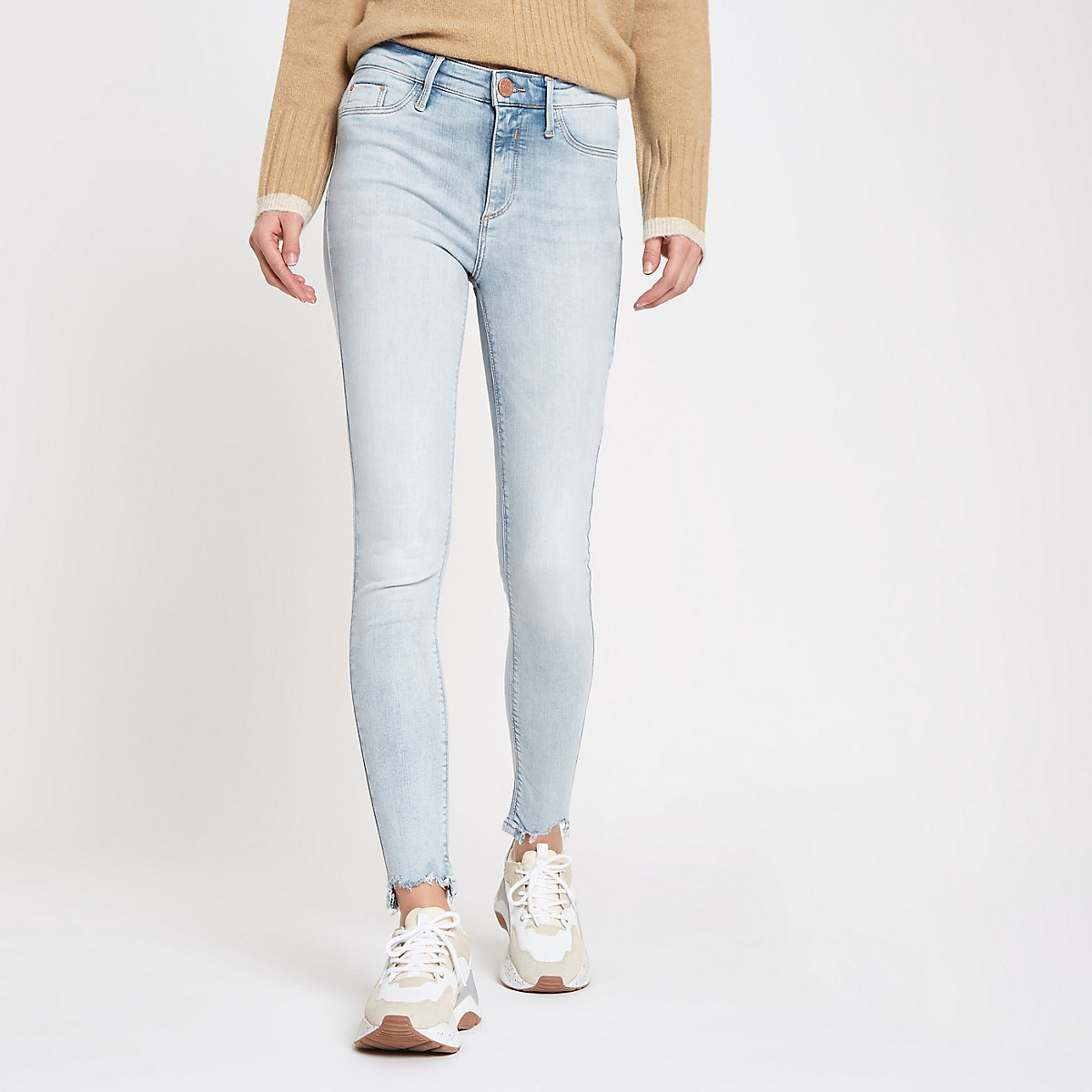 Light blue mid rise chewed hem Molly jeggings
