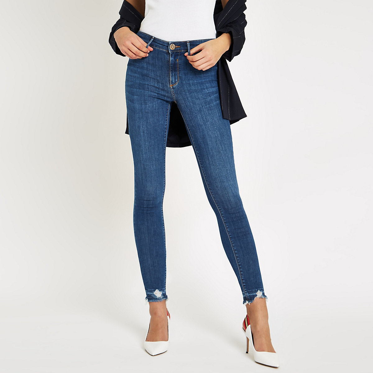 Dark blue ripped hem Molly mid rise jeggings