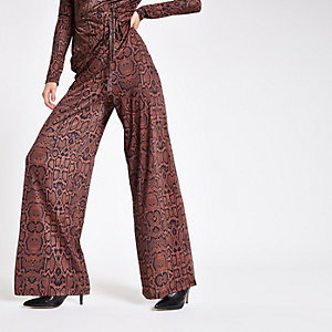 Brown snake print wide leg trousers