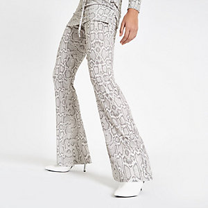 Grey snake print flared jersey trousers