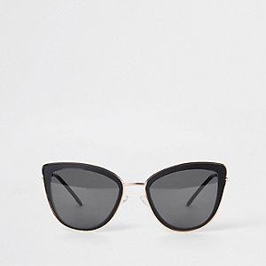 Schwarze Cateye-Sonnenbrille mit Goldbesatz