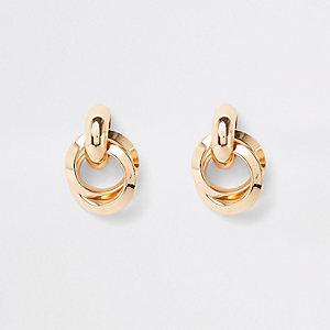Gold tone hoop twist stud earrings