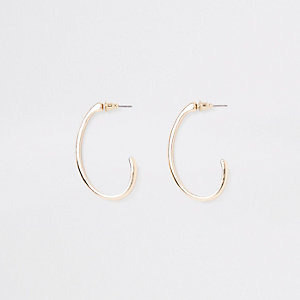 Gold tone small oval hoop earrings