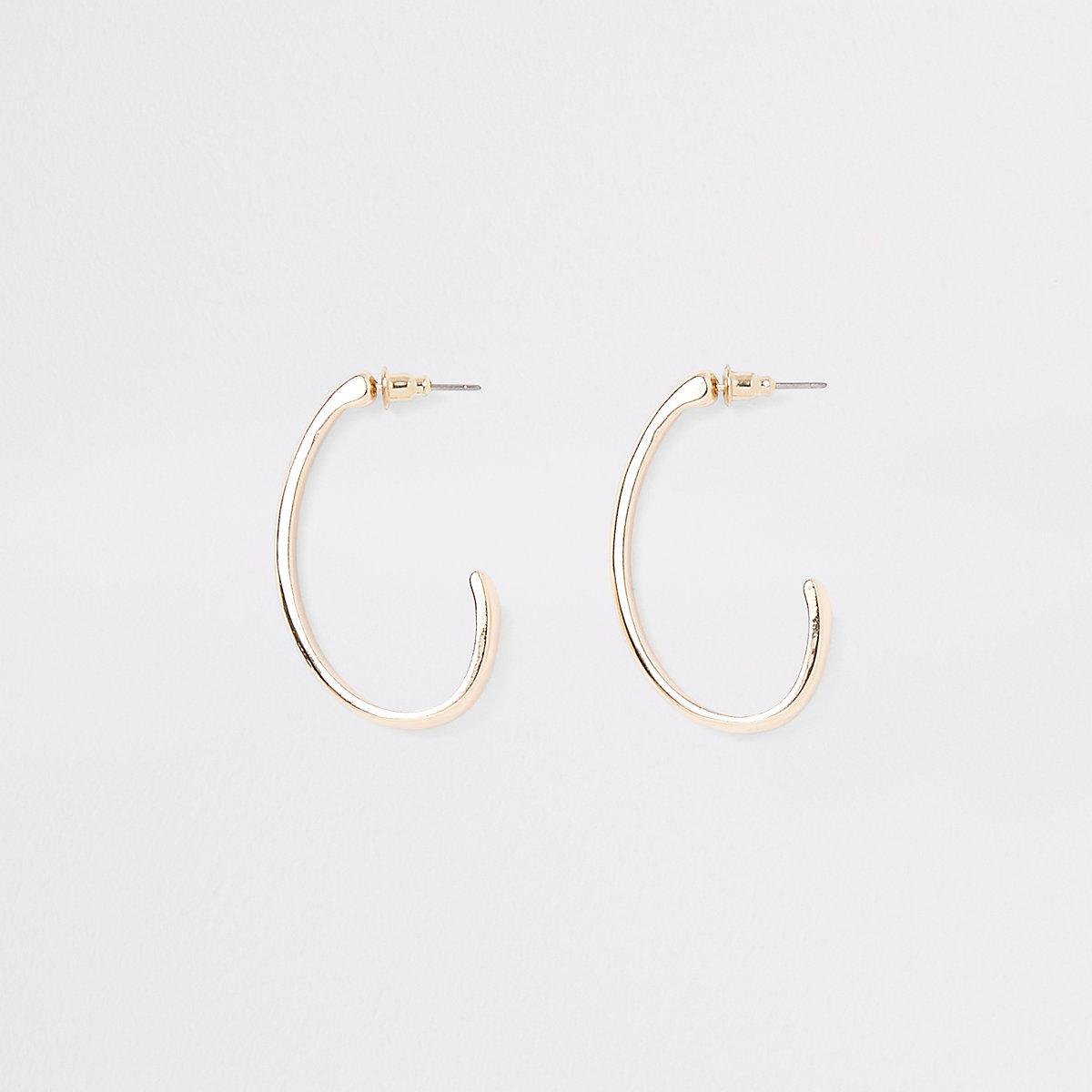 Gold tone small oval hoop earrings