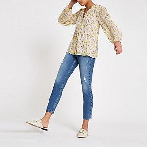 Paarse blouse met bloemenprint en strikceintuur