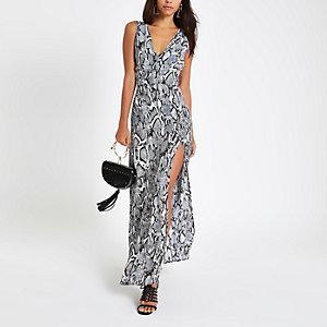 Beige diep uitgesneden maxi-jurk met slangenprint