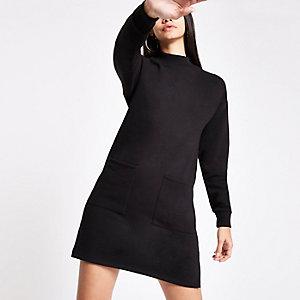 Robe pull noire avec poches plaquées