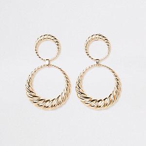 Goudkleurige gedraaide oorhangers met dubbele ring