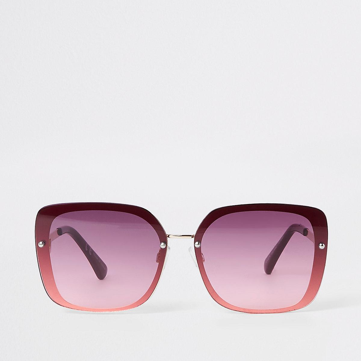 Gold tone dark red aviator sunglasses