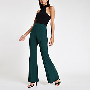 Green flared leg jersey pants