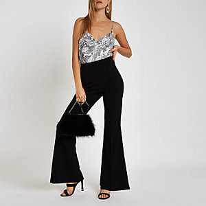 Black flared leg jersey pants