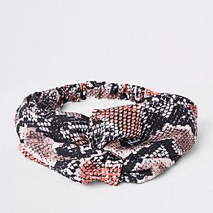 Pink snake print twist headband