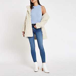 Light blue cut away turtle neck vest