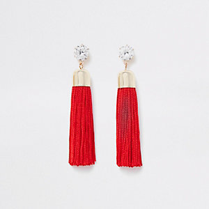Gold tone red diamante tassel drop earrings