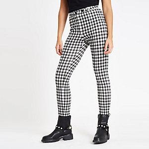 Pantalon skinny en maille point de Rome motif vichy noir