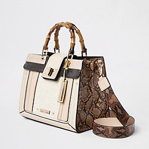 Cream snake print bamboo handle tote bag