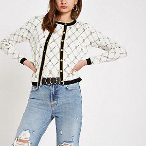Crème vest met geometrische hartprint